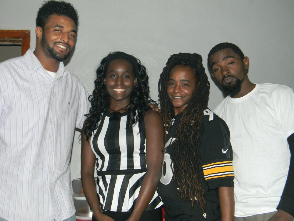 My older brother, me, my mother, and my younger brother.